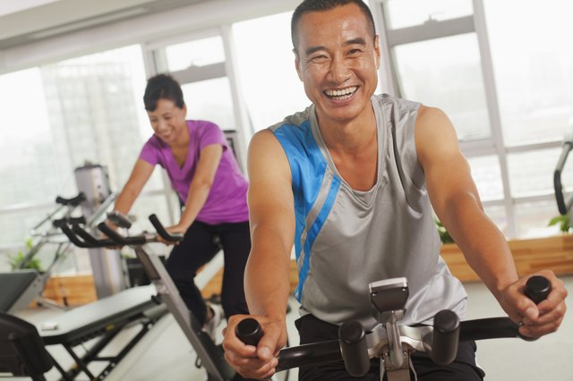 Man smiling and exercising on the exercise bike