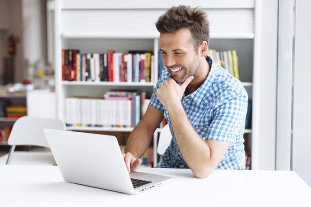 Casual man working on laptop