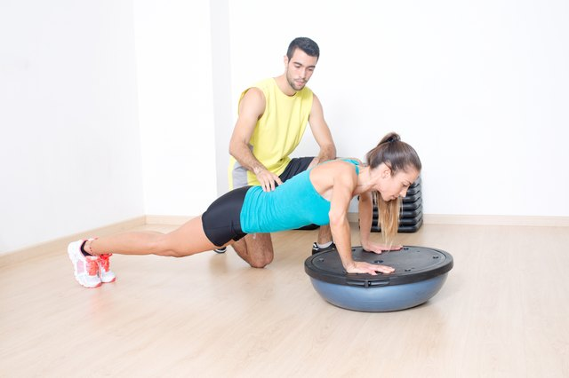 Bosu exercise with coach