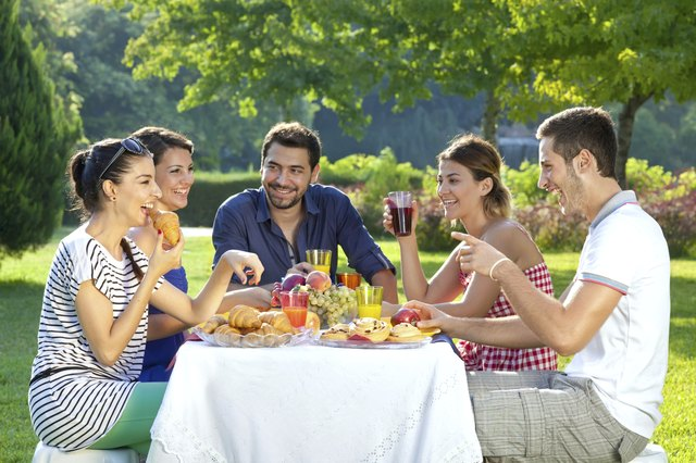 Friends enjoying a healthy outdoor meal