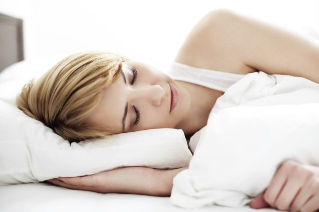 Portrait of young woman sleeping in the bed