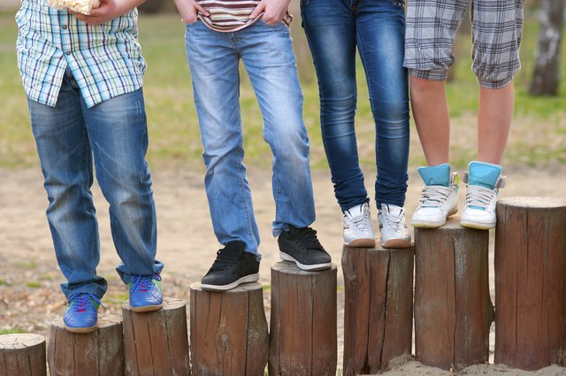 Legs and sneakers of teenagers
