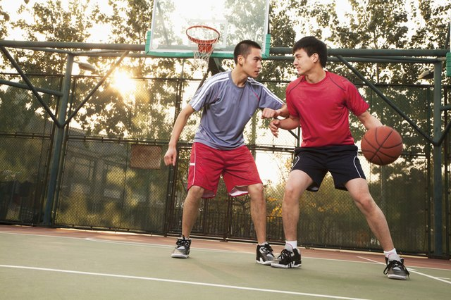 Two street players on the basketball court