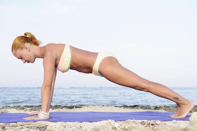 Yoga practice - Slim woman practicing plank pose