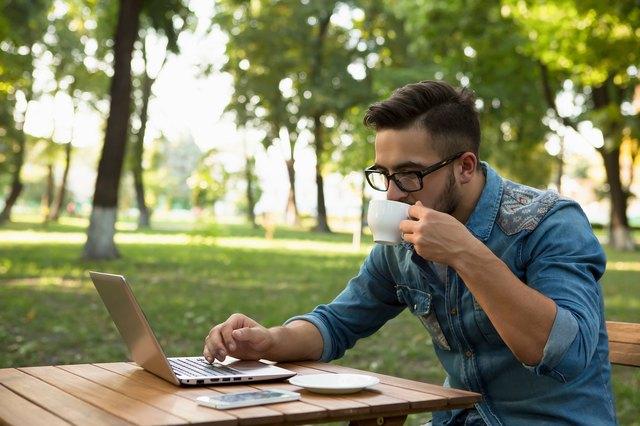 Freelancer hipster man drinking coffee