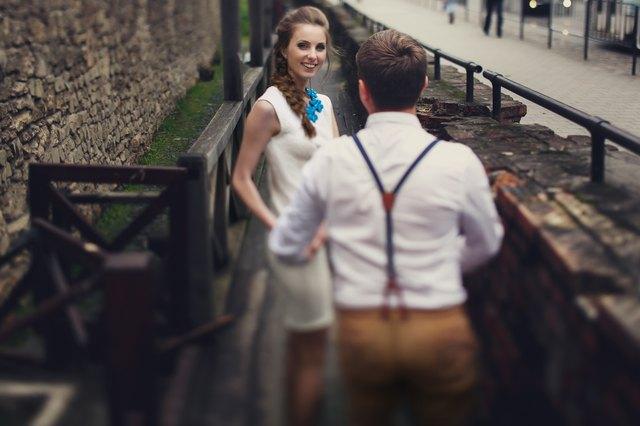 couple walk in old town lviv,kissing,loving.