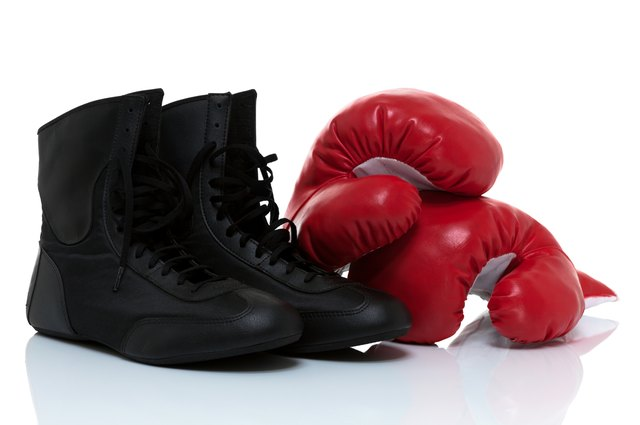 Boxing gloves and shoes isolated on white