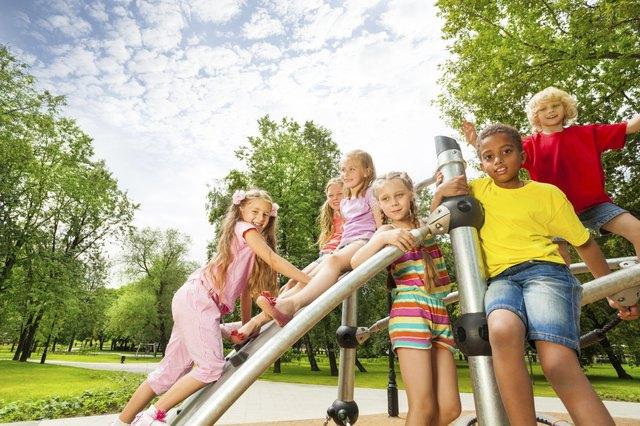 Kids on playground construction play, girl climb