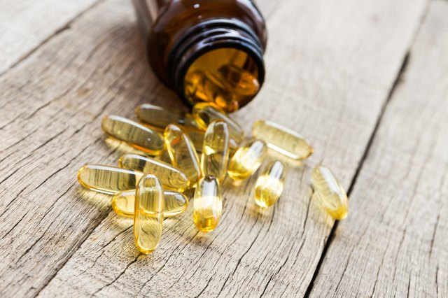 fish oil capsule on wood background