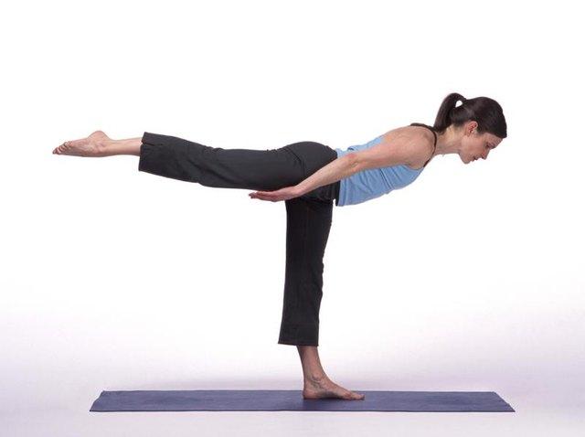 Caucasian Woman Posing On A Blue Yoga Mat