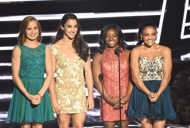 NEW YORK, NY - AUGUST 28:  Madison Kocian, Aly Raisman, Simone Biles and Laurie Hernandez present Best Female Video onstage during the 2016 MTV Video Music Awards at Madison Square Garden on August 28, 2016 in New York City.  (Photo by Michael Loccisano/Getty Images)