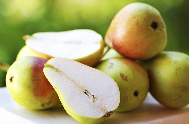Ripe pears on table