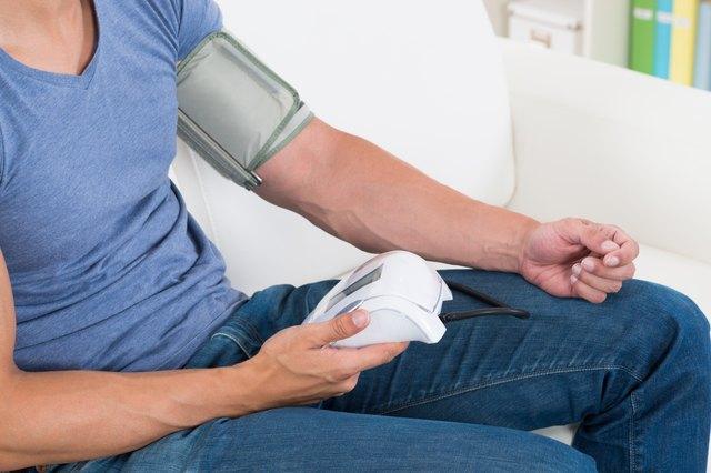 Man Measuring His Blood Pressure
