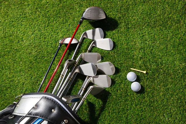 Golf clubs in the bag,balls and tee on grass