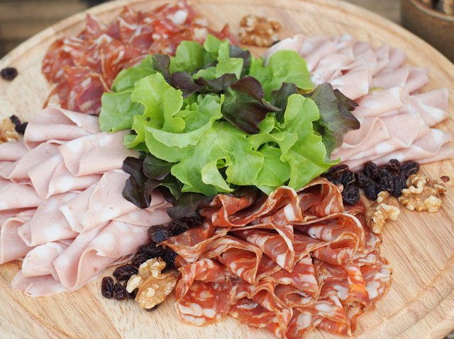 Mixed Sliced Meat on the wooden Board