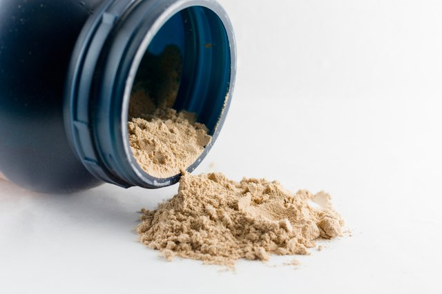 Whey protein chocolate powder isolated on white background.
