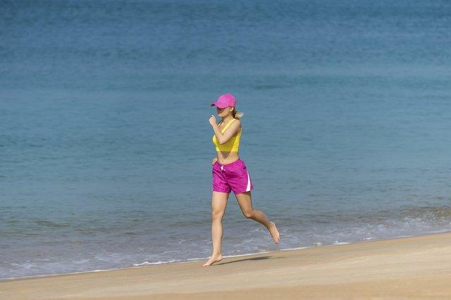 Healthy Woman running on beach