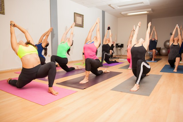 Low lunge in a big yoga class