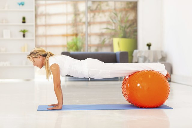 middle aged woman doing push ups