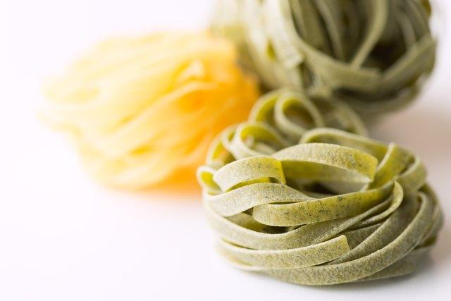 Dry pasta background on white