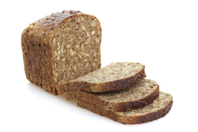 Sliced brown bread with cereals.