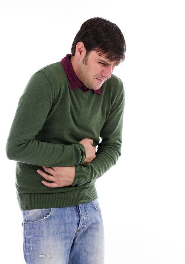 Young man with strong stomach pain