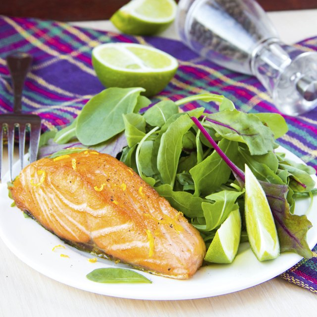 Grilled fillet red salmon and salad with lettuce, lime