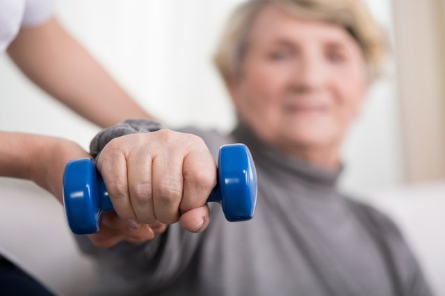 Elder woman training with physiotherapist