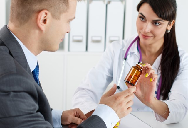 Beautiful female medicine doctor giving pills to male patient
