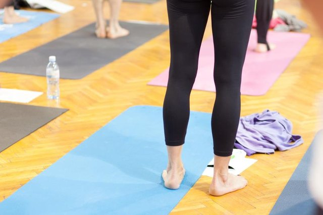 person standing at yoga class