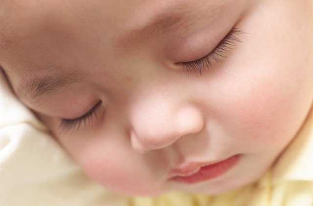 exteme close up on an asian babys face while it sleeps