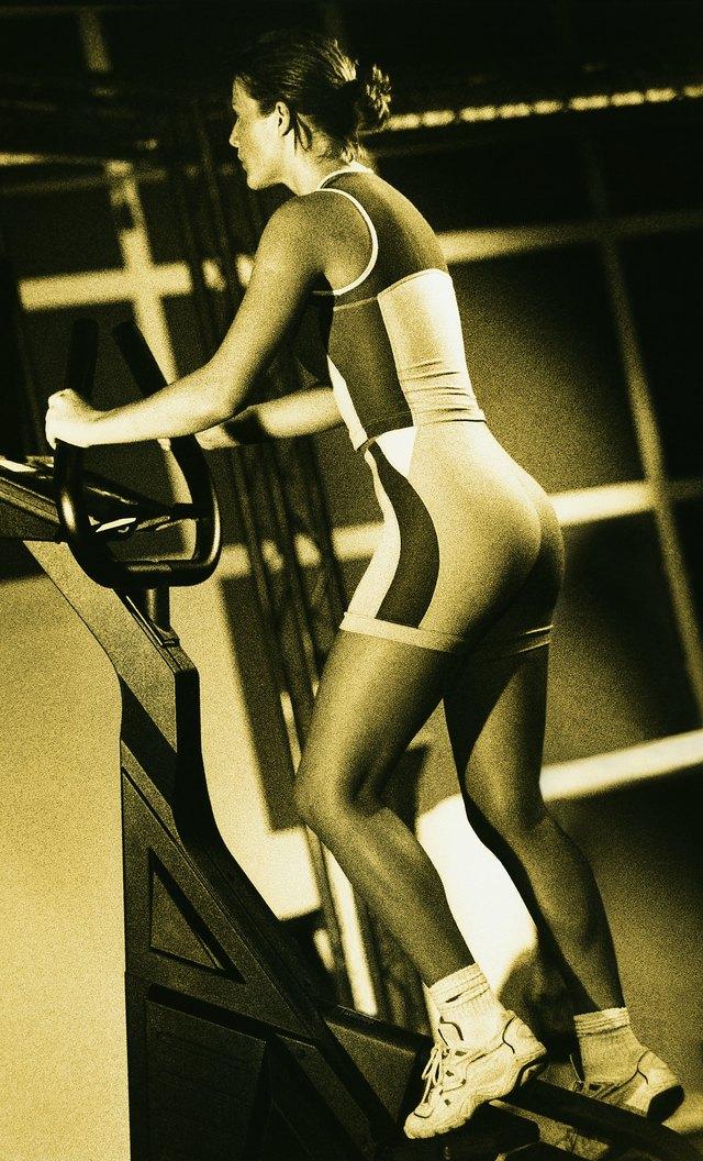 Woman using stair-climbing machine