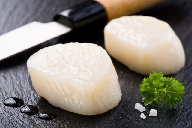 Scallops on black stone plate