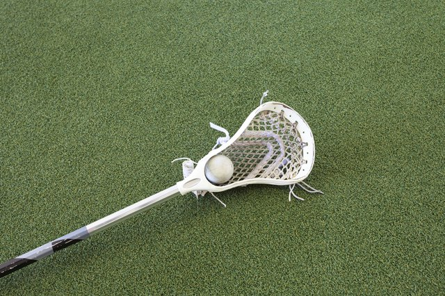 Lacrosse Stick and Ball on Turf