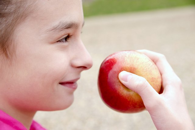 people, children, healthy eating and food concept- happy girl ho