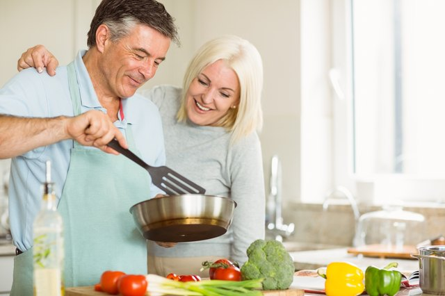 Happy mature couple making dinner together