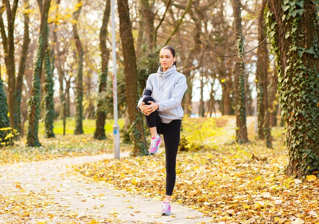 Young woman with headphones preparing for a jogging