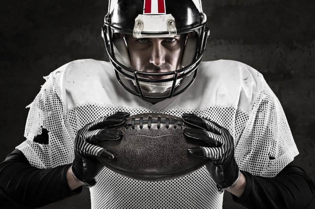 Portrait of american football player holding a ball