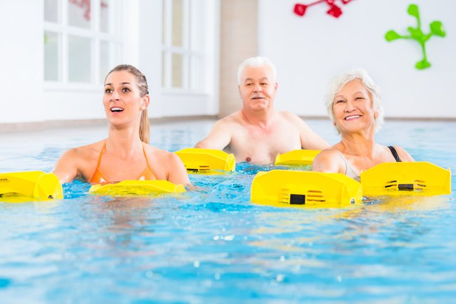 Senior and young people in water gymnastics