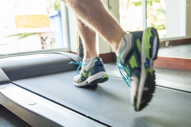 Close up male foot running on treadmill