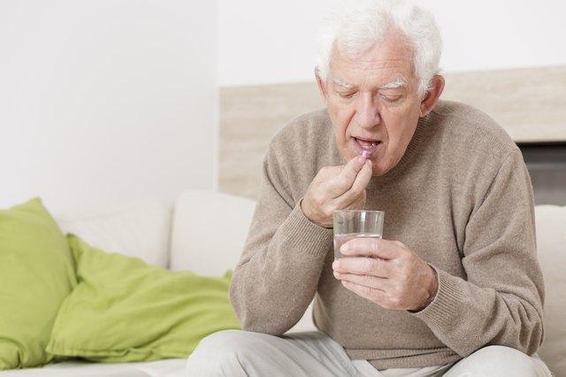 Ill man taking medicine