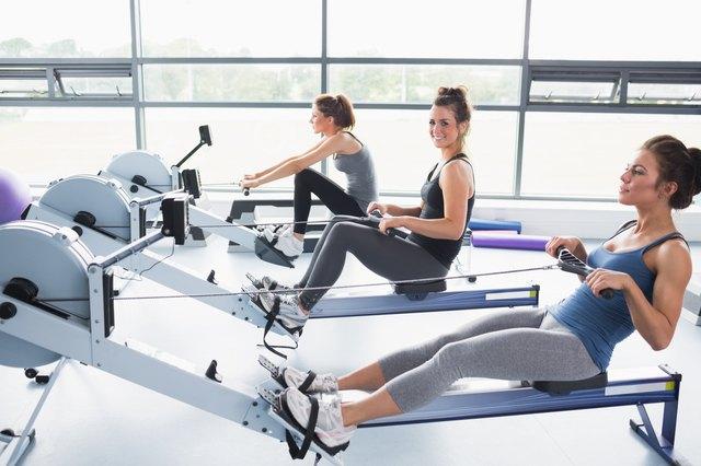 Three women exercising on rowing machines