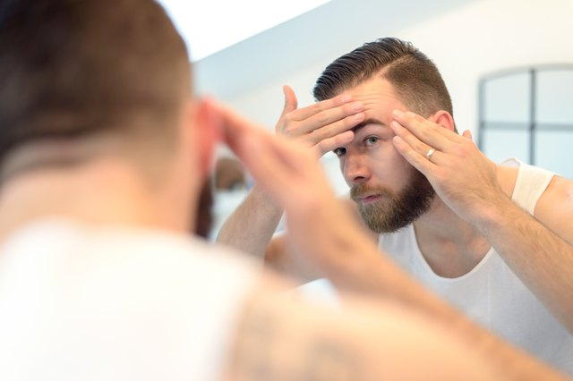 Bearded man checking his complexion