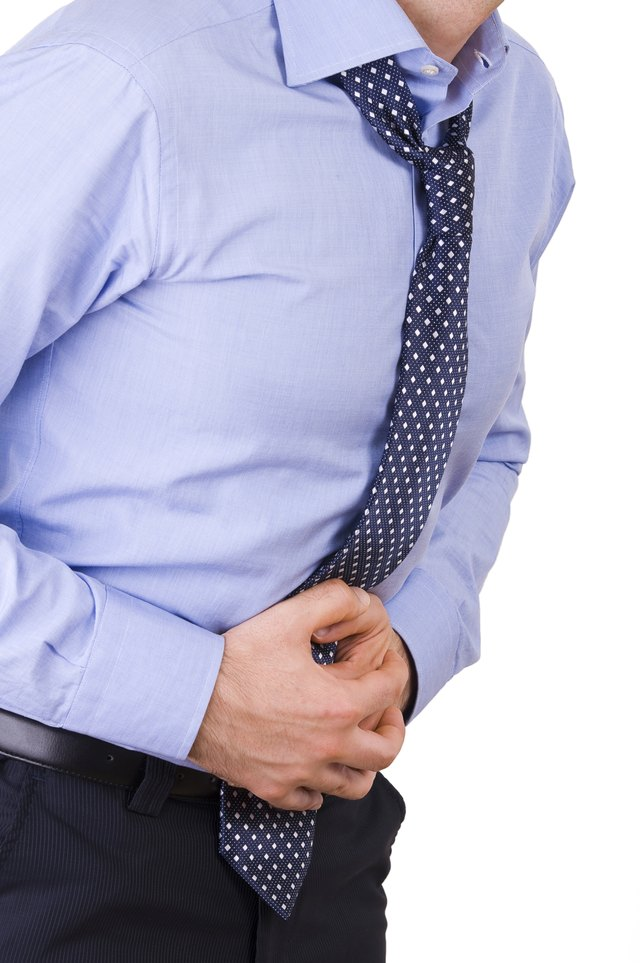 Businessman suffering from stomach pain.