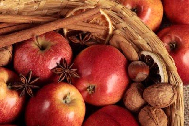 Apples, cinnamon sticks, walnuts, almonds, anise and dry orange slices.