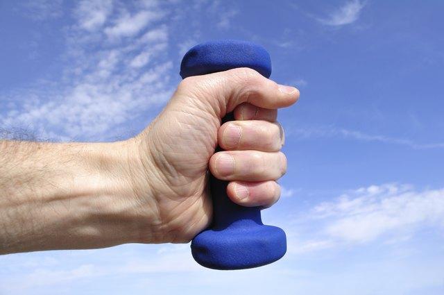 Hands Holding Blue Weight