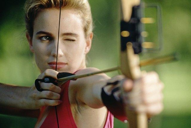 Woman aiming bow and arrow