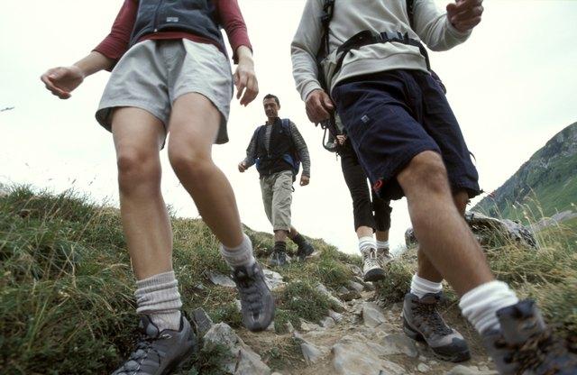 Men and women hiking down mountainside