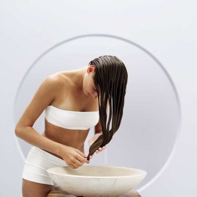 portrait of a woman washing her hair in a basin