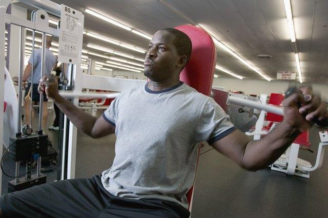 Man using weight machine in gym